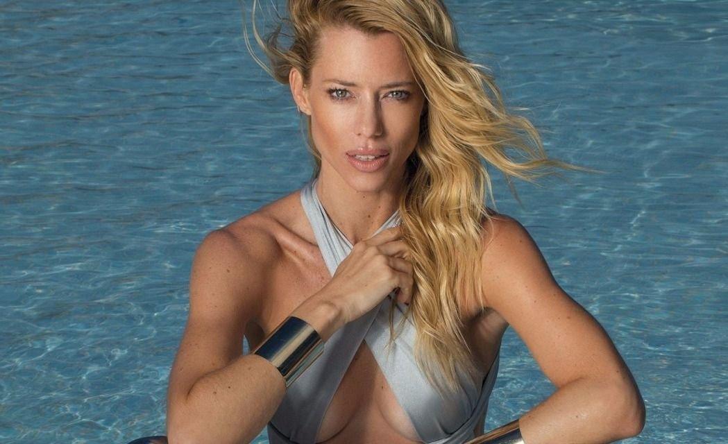 De cola y tomando sol: Nicole Neumann fue sorprendida en la playa